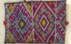 A rare find and truly a collectible piece, this pillow cover, fashioned from old Zaiane rugs, is a stunning example of the signature diamond motif pattern, featuring colors of red, green, yellow and black. It may have been created as a gift, having once had rows of sequins which are long gone. The Zaiaine tribe of the southern Middle Atlas mountains, according to our information, is no longer weaving rugs. It is said that if one finds a Zaiane textile it is likely to be old. New...