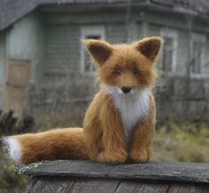 Cutest little felted fox cub ever!  This woman's animals are adorable.