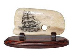 """Heading to San Francisco"" Black and White Scrimshaw on Ancient Walrus Tusk Ivory Artifact by Gerry Dupont. A full rigged clipper ship makes good time heading for California with a load of gold seekers hoping to strike it rich. During the Gold Rush many crews jumped ship and headed inland as well. Nice artifact, not many of these left anymore. Probably 500-1500 years old. Size: 4 3/4""W x 1 1/2""D 2 1/2""H  Price: $375.00  -- on ScrimshawGallery.com #scrimshaw"