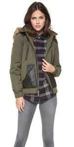 This ASTRID Hooded Bomber Jacket goes along with the current fashion of American patriotism. This jacket has both aesthetic and functional purposes. The faux fur lined hood and leather pockets show that this jacket will keep you warm. This jacket can also be paired with a variety of different outfits, making it very versatile. Miranda C