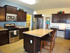 Standard Kitchen -Maple Cabinets, Granite Counters, 18x18 tile