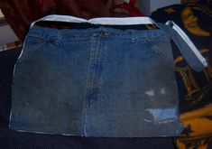 How to Make a Messenger Bag out of an Old Pair of Jeans