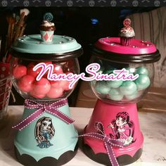 Monster higj gumball jars made by NancySinatra 2016.  Pink and aqua. With cupcake toppers.