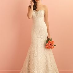 Style: 2850 - Gorgeous lace and Swarovski crystals adorn this exquisite gown.