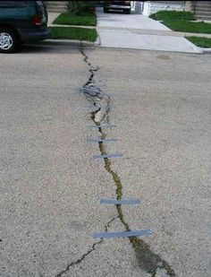The citizens who duct taped this street back together. | 28 People Who Totally Fixed Everything