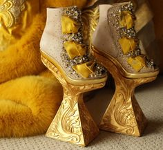 Designer: Guo Pei The Venetians use to wear their shoes so high that their servants use to have to walk alongside of them being leant on by the wearer.