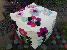 Bean bag covered in crocheted flowers