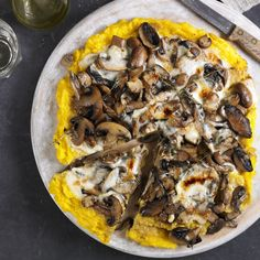 In this recipe, using polenta as a pizza base makes for a very quick and filling laid-back supper