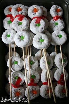 "Snowman on a Stick: Mini Sugar Donuts with Jelly Bean / Gum Drop (sample used Mike & Ikes) and Fruit Roll Up Scarf; Site also shows idea for ""Snowman"" look juice boxes and a Snowman themed hot cocoa bar"