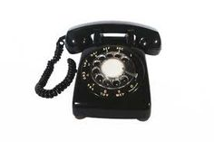 We had one phone in the house.  It looked like this.  You had to put your finger in the dial and turn it for each number of the phone number you were dialling.  When someone called you, it had a bell ring, that was it, not other options.  Was a land line.  Was fully wired.  No call waiting.  No answering machine.  But it worked, loud and clear.