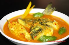 """IKAN KUAH KUNING - YELLOW FISH SOUP:Maluku Islands which are rich with fish and exotic spices, indeed well-known for their's distinctive fish-based cuisines. A famous dish among them is """"Ikan Kuah Kuning or Yellow Fish Soup"""". The name already suggest it's character which's dominated by the yellow tends to orange colour, which derived from the ground turmeric."""