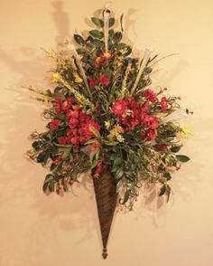 Decorative Wall Sconces For Flowers elegant ranunculus surround an emerging protea bud amid millet