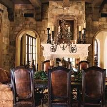 Rustic And Yet Sophisticated Spanish Colonial Retreat The Living Room S Two Way Fireplace Boasts