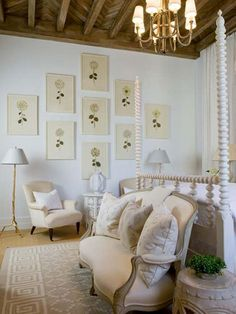 Pretty botanicals, custom framed in light-toned frame mouldings. A lovely wall composition for the space.