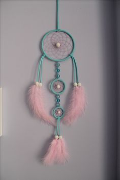 Blue Dream Catcher with pink feathers and white hand painted beads! Made by Little Witch Project
