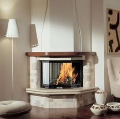 Corner Fireplace Ideas - Warming up your room with some corner fireplace ideas for your house. Some people might not feel comfortable about placing the fireplace area in the corner because it's not the most common design of a fireplace. Ventless Fireplace Insert, Corner Gas Fireplace, Country Fireplace, Modern Fireplace, Fireplace Design, Fireplace Ideas, Fireplace Garden, Modern Country, Paint Your House