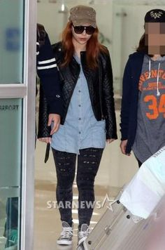 Ailee arriving back in Korea today, keeping a low profile.