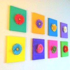 We made these for our livingroom wall out of 8 small canvases painted and 8 gerber daisies hot glued on. Try it with any colors you want! Have some fun with it!