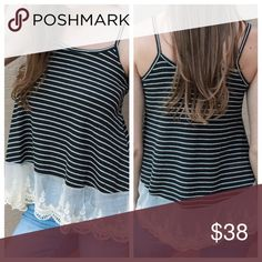 Striped Tank with Lace This ribbed sweater tank has just the right amount of lace! This too has spaghetti straps, black and ivory stripes and the cutest ivory lace hem. 65% cotton, 30% polyester, 5% spandex Tops Tank Tops