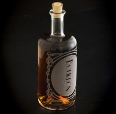 Spirit decanter made from re-purposed liquor bottles and beautifully laser etched- at Makers Market. $40 Made in the USA.