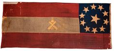 This flag belonged to the Dallas Artillery (also known as Hart's Battery), of Arkansas. While crossed cannons often meant recognition of a captured battery, this particular flag has the decoration to designate it as artillery. A nice example of a First National that has been recently conserved and resides in Arkansas, as it should. The museum notes it as one of just two artillery flags in existence from Arkansas.
