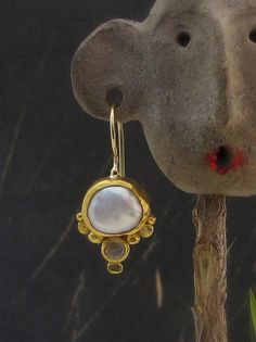 Stately yet vibrant, these freshwater pearl earrings are a wonderful pair for your formal wear. Handmade with gold balls, white crystal, and of course, the