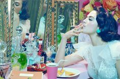 Short Breaths #2, 2012 Chromogenic print  First published in Vogue Italia, November 2012 © 2013 Miles Aldridge - Pink tones, low saturation, pink cigarette and matching cup, mirrors, excess.