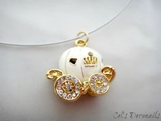Pumpkin carriage necklace--while Cinderella is one of my least favorite princesses, the fantasy of this necklace is so gorgeous.  fairytales for life