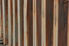 Rusty sea wall at the docks