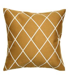 Mustard yellow/patterned. Cushion cover with a jacquard-weave pattern at front and solid color at back in woven cotton fabric. Concealed zip.