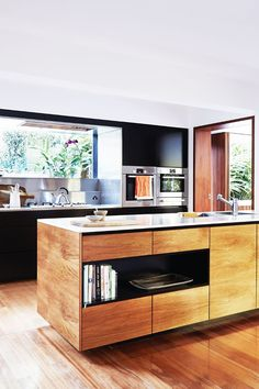 Step Aside, White Kitchens—Why Wood Finishes Are Becoming a Design Favorite