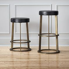 """<span class=""""copyHeader"""">retro ringer.</span> The classic diner-style stool comes full circle in this modern interpretation by Chicago-based designer Mark Daniel of Slate Design. Daniel reveals """"the defining element of the barstool is the repeated disc of the seat, footrest and base."""" Hand-distressed with an antiqued brass finish, welded steel structure rises to the perfect counter or bar height. Cushy foam seat is upholstered in authentic leather that's drum-dyed rich black and intricately…"""