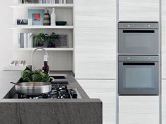 The Essenza #kitchen features sober, linear forms and is enriched by the refined tactile and visual character of the #wooden finishes, coupled with the numerous #colour varieties of the doors which brighten up the composition abd create a pleasant contrast.