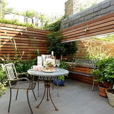 Compact city garden with wall mounted planters | Urban garden ideas | housetohome.co.uk