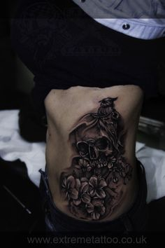 Skull with bird flowers tattoo, Gabi Tomescu.Extreme tattoo&piercing. Fort William.Highland
