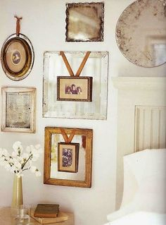 All About Vignettes: Design Musings-----Relocated Art with a ribbon layered on a mirror