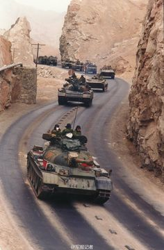 Type 59 tanks leading motorized convoy during exercise in western China, circa 1990s