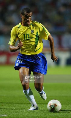 Rivaldo of Brazil runs with the ball during the FIFA World Cup Finals 2002 Group C match between Brazil and China played at the Seogwipo-Jeju World Cup Stadium, in Seogwipo, South Korea on June Brazil won the match DIGITAL IMAGE. Brazil Football Team, Best Football Players, National Football Teams, Soccer Players, Champions League, Legends Football, Association Football, E Sport, International Football