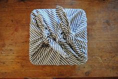 Furoshiki is Japanese, starting in the 1300's for keeping your clothes dry in bath houses. Now used for gift wrapping and carrying things by tying knots in a variety of styles.