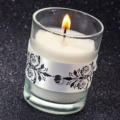 Our DIY Fleur de lis Candle Holder will add a touch of elegance and style to your party decorations.