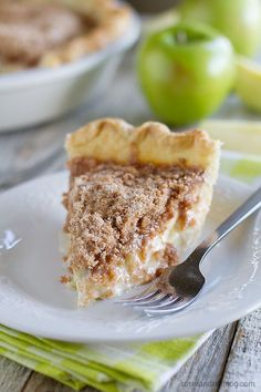 Sour Cream Apple Pie - apples are combined with a spiced sour cream mixture, then topped with lots of crumbly streusel in this favorite apple pie recipe.