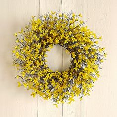 """Forsythia Wreath: Bright yellow forsythia sprouts from a bramble of twigs—an artful juxtaposition of color and texture that captures the beauty of spring after winter. Our wreath is woven by hand using faux forsythia blossoms and natural quail brush. This arrangement makes a lovely gift for spring and brings cheerful color to your home year-round. Protect from weather. 18"""" diam. A Williams-Sonoma exclusive."""
