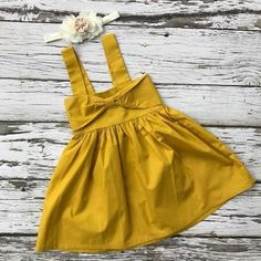 Baby girls dress by Kadees Kloset. Popular color of the year! The front bib has a knotted centered giving it a bit of dimension. Yellow Gown, Girls Dresses, Summer Dresses, Classy Dress, Ladies Dress Design, Stylish, Sweaters, How To Wear, Clothes