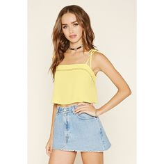 Forever21 Cutout-Crochet Cropped Cami (15 CAD) ❤ liked on Polyvore featuring tops, light yellow, cropped camisoles, crochet crop top, strappy tank top, cami tank and crop tank