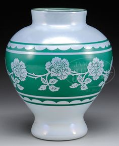 James D. Julia, Inc. -  Durand Cameo Art Glass Vase. Bulbous form vase is decorated with a cameo design of white flowers on a green ground.