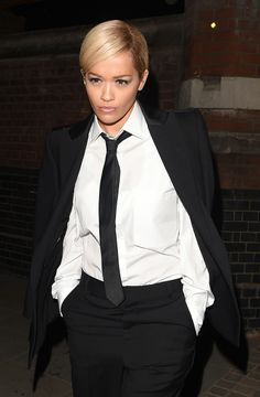 Tracing the transformations of beauty chameleon Rita Ora on Vogue.com. : Love this menswear outfit.