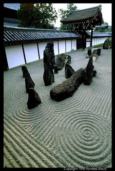 Japanese Rock Gardens (or Karesansui) are made from just two primary elements: rocks and a fine, light coloured gravel. This is a garden my mom could appreciate.
