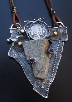 Richard Salley Jewelry Pendant made based on Found Objects, like an old Indian Head Nickle, and a Garden Stone