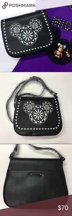 Vera Bradley Black Mickey Mouse LaserCut Crossbody Beautiful black Mickey Mouse bag from Vera Bradley! Features magnetic flap closure and exterior pocket. Interior zippered pocket with faux-leather pull. Two open top pockets, including a cell phone pocket. Bag is fabric lined and has silver-toned hardware. There is even an embossed Vera Bradley label on the back! Dimensions: 8''H x 10''W x 2.5''D. NWT. Vera Bradley Bags Crossbody Bags