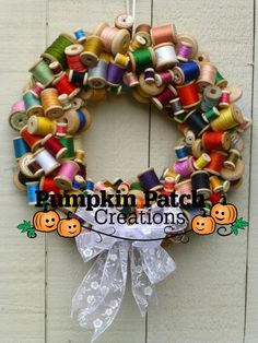 Vintage wooden thread spool wreath, handmade, home decor, wall hanging, alternative, sew, quilt, craft, craft room, gift by PumpkinPatchDecorCA on Etsy